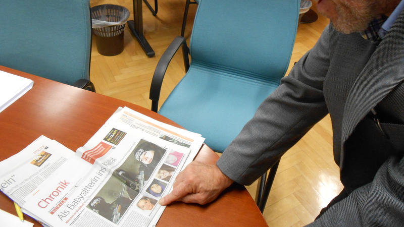 <p>Peter Slanar, principal of Vienna's Higher Commercial Vocational School, looks at a news story about his former student Samra Kesinovic who joined up with ISIS in Syria.</p>