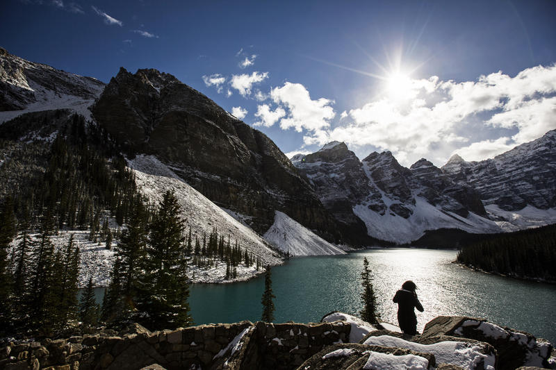 <p>A woman looks over Moraine Lake in Banff National Park, in the Canadian Rocky Mountains, outside the village of Lake Louise, Alberta.</p>