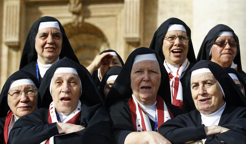 <p>Nuns look on as Pope Francis arrives to lead his weekly audience in Saint Peter's Square at the Vatican on October 22, 2014. </p>