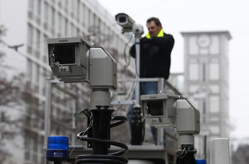 <p>A man assembles police observation cameras near the Bayerischer Hof hotelbefore the start of the 50th Conference on Security Policy in Munich on January 31, 2014</p>