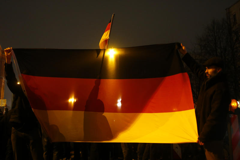 <p>Participants in a grassroots anti-Muslim movement hold German flags during a demonstration in Berlin. The rise of the group, Patriotic Europeans Against the Islamisation of the West, has shaken Germany's political establishment.</p>