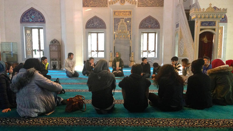 <p>Betul Ulusoy, center back, leads an educational tour of Sehitlik Mosque in Berlin.</p>