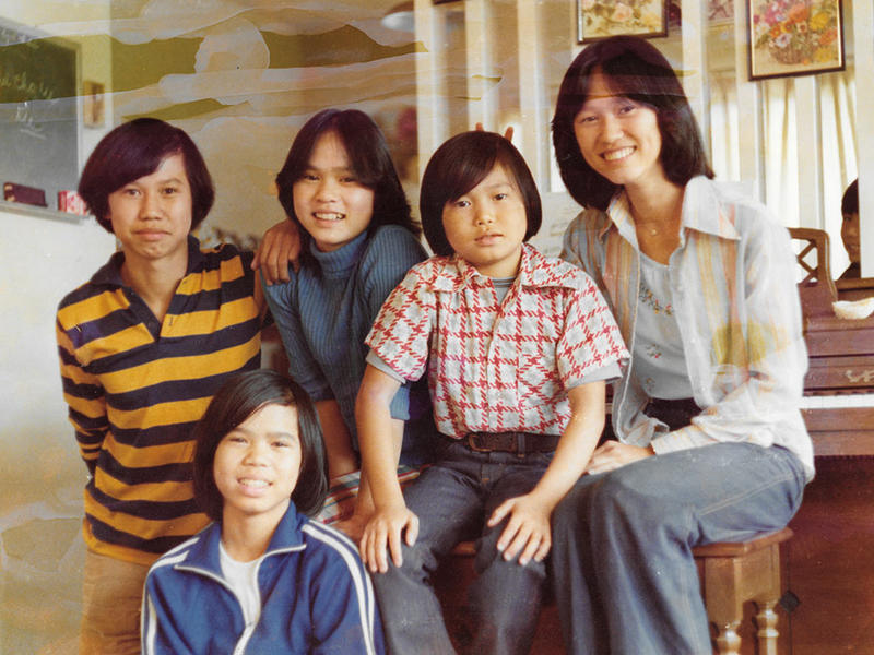 <p>The Truong family arrived to the United States not long after fleeing Vietnam in 1975,when the then-capital ofSouth Vietnam, Saigon, fell to theNorth Vietnamese army.Thu-Thuy Truong, far right, places bunny ears above herbrother, Sy.</p>