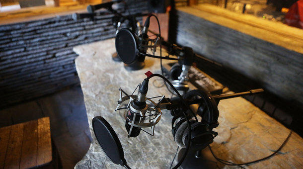 Microphones and other equipment in a recording room.