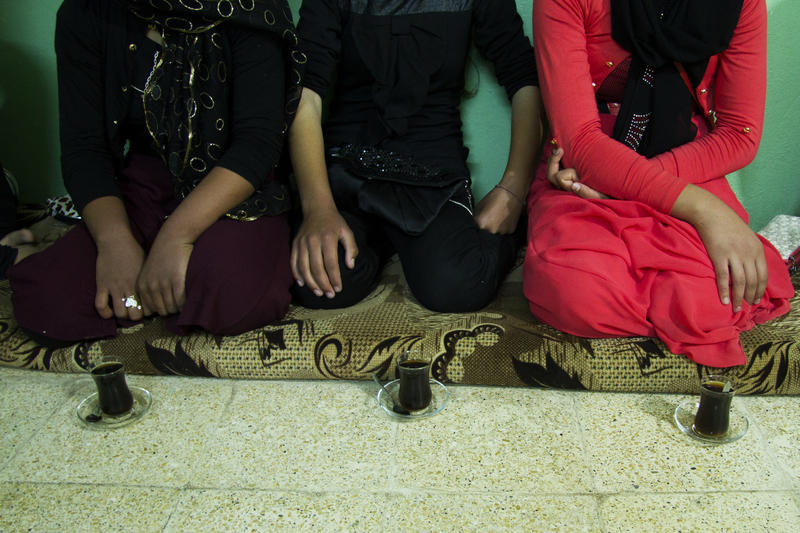 <p>Yazidi women released from ISIS captivity meet with Lalish'stop spiritual leader, Baba Chawish, before being baptized back into the faith.They didn't want to show their faces.</p>