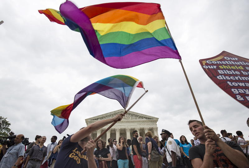 <p>Gay marriage supporters wave flags after the Supreme Court voted 5-4 in favor of marriage equality.</p>