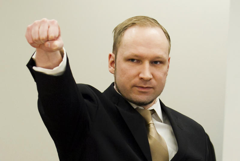 <p>Norwegian mass killer Anders Behring Breivik gestures as he arrives for his terrorism and murder trial in a courtroom in Oslo April 16, 2012.</p>