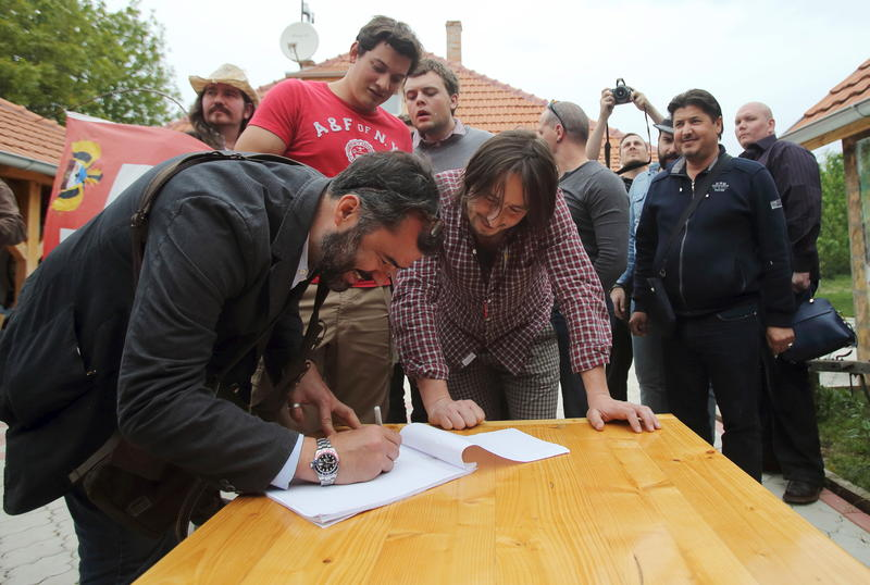<p>A man applies for Liberland citizenship in the village of Backi Monostor, Serbia. A Czech citizen, Vit Jedlicka, has proclaimed a new sovereign state lying on the border between Croatia and Serbia. </p>