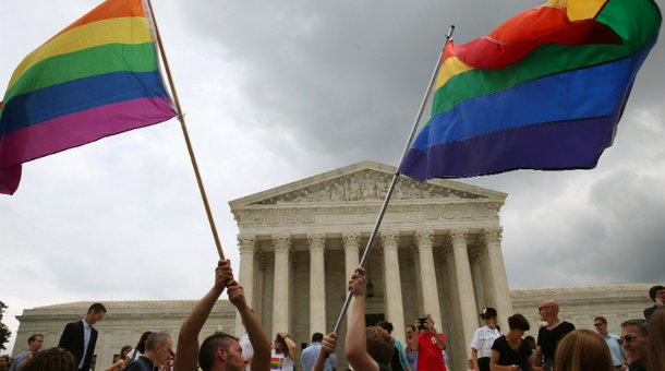People celebrate in front of the U.S. Supreme Court after the ruling in favor of same-sex marriage Friday in Washington, D.C.