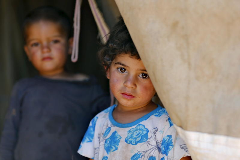 <p>A Syrian refugee child who has been living in a tent in Jordan since fleeing her hometown of Idlib.</p>