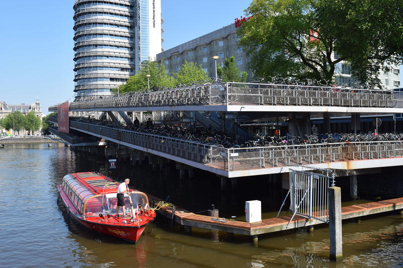<p>A bike parking lot at Amsterdam Centraal Station is packed with commuter bikes. Municipal workers come through daily to tag and tow bikes that are improperly parked or left for too long. </p>