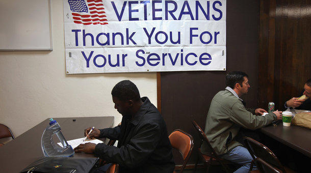 Unemployed U.S. Air Force veteran Tracy McConner, 45, registers at the Military and Veterans Employment Expo in Golden, Colorado.