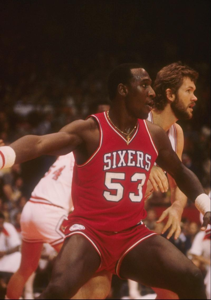 Darryl Dawkins of the Philadelphia 76ers looks on during a game. (Photo Credit: Jonathan Daniel / Getty Images)