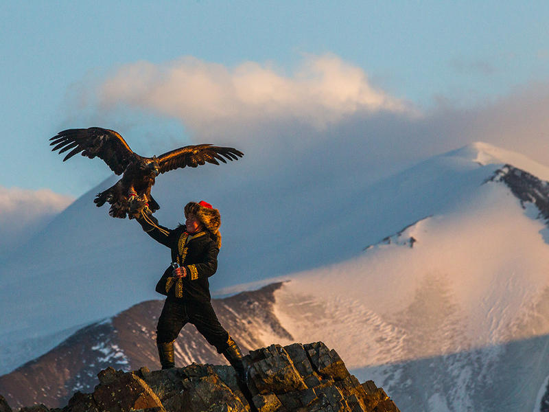 A still image from the documentary The Eagle Huntress. The film follows teenager Aisholpan Nurgaiv, the first female in a traditionally male role, as she trains a golden-eagle chick to hunt in Mongolia.