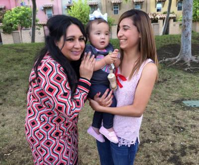 Mayor Ramona Padilla, Cassandra Baca, and her 1-year-old daughter, Amoriee.
