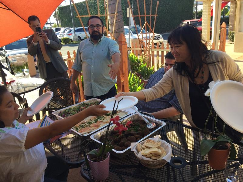 Santa Ana high school cultural ethnics and history teacher Ben Vazquez, 45, invites guests on the food tour in Little Arabia to try some of Kareem's Restaurant hummus, salad and baba ganoush.