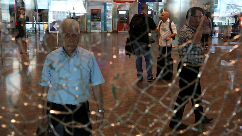 <p>A man looks at a broken glass at Istanbul Ataturk Airport, following a terrorist attack on the terminal.</p>