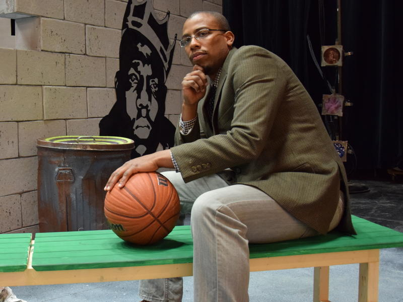 Onaje X. O. Woodbine's book, Black Gods of the Asphalt, has also been adapted into a play by the same name. He appears here on that play's set at Phillips Academy in Andover, Mass.