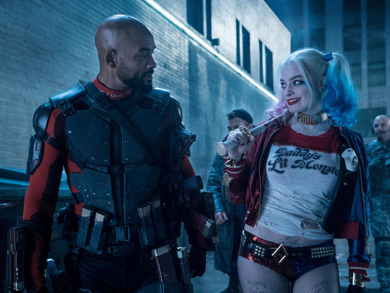 Will Smith plays Deadshot and Margot Robbie plays Harley Quinn in Suicide Squad.
