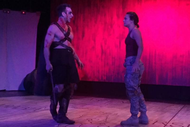 Ajax (played by Aaron Hendry) and A.J. (played by Courtney Munch) circle each other as they contemplate ending their lives. The play