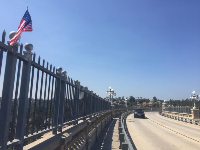 The first American flags decorate the Colorado Street Bridge. Before long, hundreds had been zip-tied to the fencing meant to discourage jumpers.