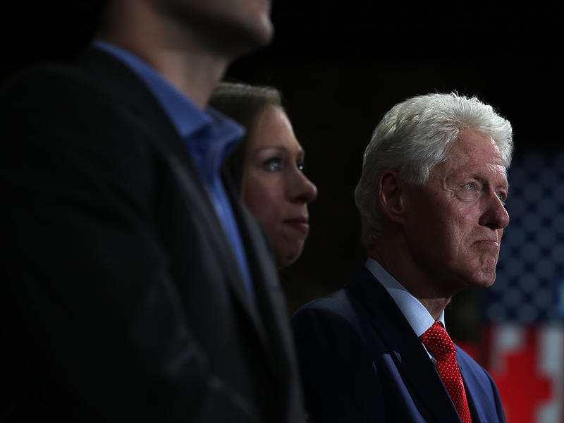 Former president Bill Clinton and his daughter Chelsea Clinton watch Hillary Clinton speak during a primary election night gathering on April 19, 2016 in New York City.