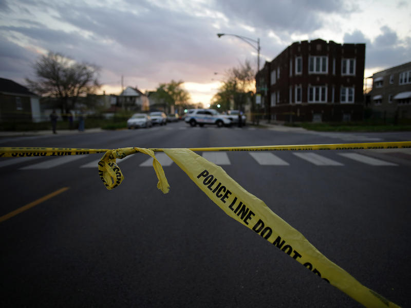 Police crime tape is displayed at the scene where a 16-year-old was shot and killed and an 18-year-old was shot and wounded on April 25 in Chicago.