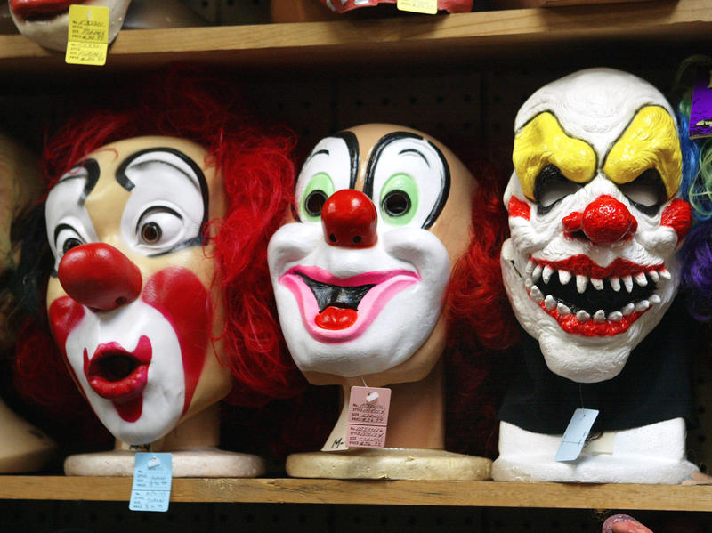 Clown masks are displayed at the Fantasy Costumes HDQ. store in Chicago in 2003.