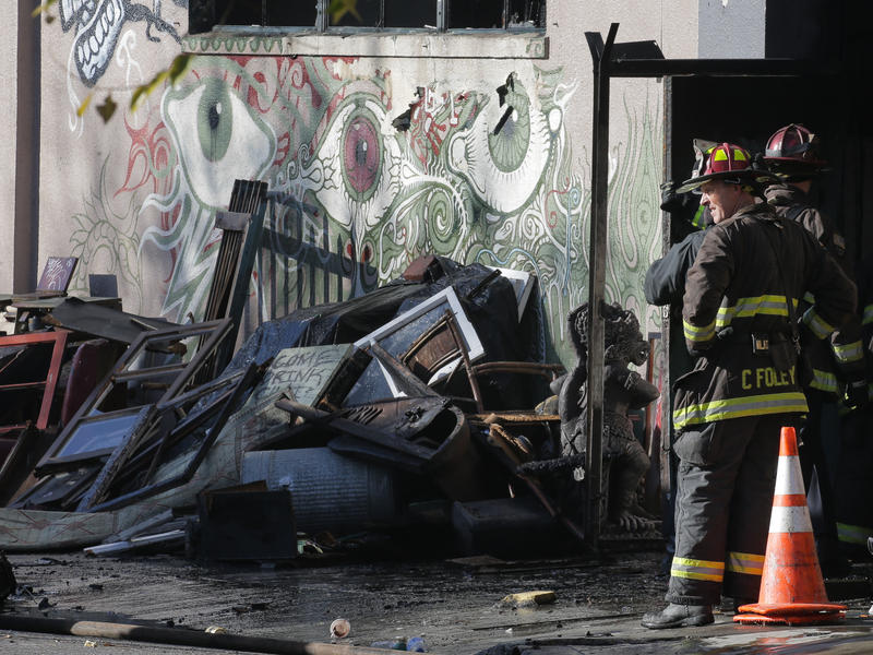 A collapsed roof and debris slowed down the recovery efforts of firefighters on Dec. 3 following a fire that killed at least 30 people at a warehouse in Oakland, Calif.