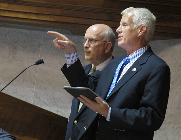 The state's leading education lawmakers want to extend Pearson's testing contract, to avoid rushing into a botched replacement for ISTEP+. In this 2013 file photo, House education committee chair Bob Behning (left) and Senate education committee chair Den