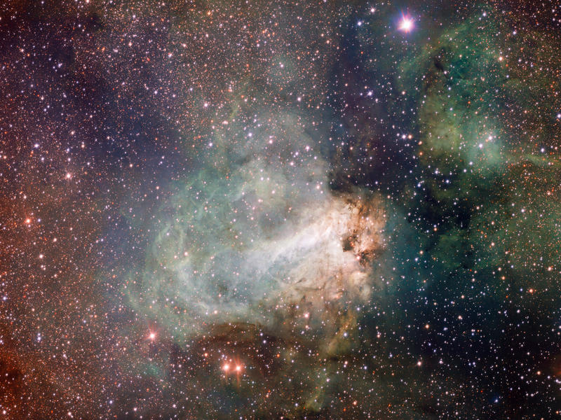 The star-forming region Messier 17, also known as the Omega Nebula or the Swan Nebula, is a vast area of gas, dust and hot young stars lying in the heart of the Milky Way in the constellation of Sagittarius.