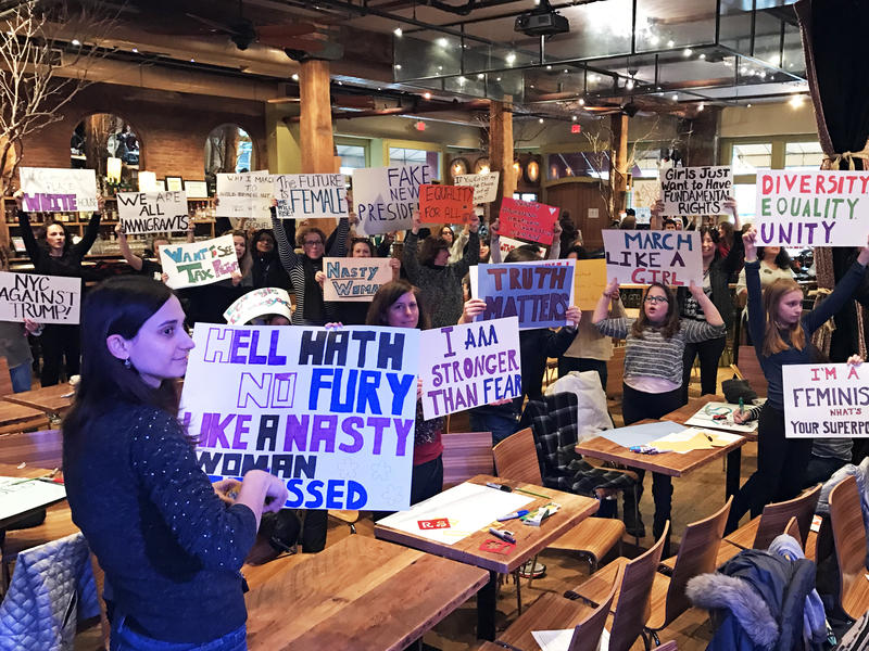 Protesters hold up their handmade signs as they prepare for the Women's March on Washington.