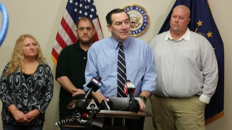 At his Indianapolis office, U.S. Sen. Joe Donnelly (D-Ind.) details legislation he plans to file that would punish companies for cutting American jobs and moving overseas. (Lauren Chapman/IPB News)