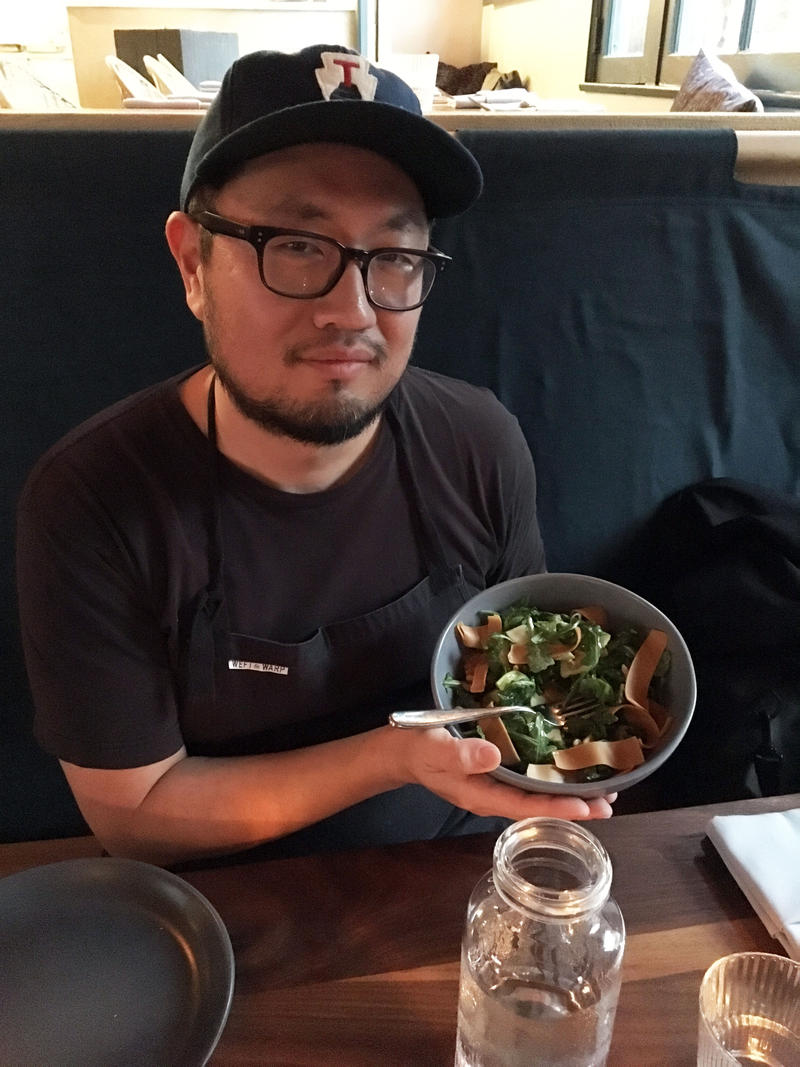 Chef Jason Kim posing with the gjetost-topped salad.