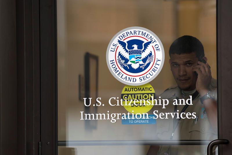 <p>A security guard looks out of the US Citizenship and Immigration Services offices in New York, on Aug. 15, 2012.</p>