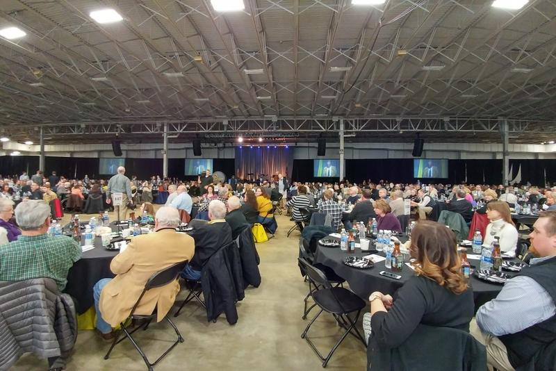 Purdue Agriculture alumni applaud honorees at their annual Fish Fry in Indianapolis. (Annie Ropeik / IPB News)