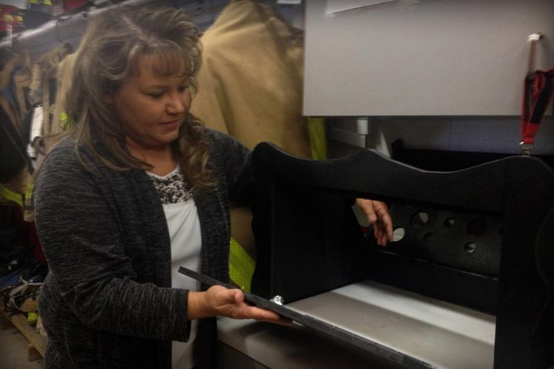 Monica Kelsey opens the baby box prototype in this 2015 file photo. (Gretchen Frazee/WTIU)