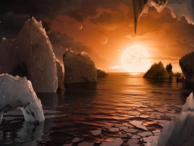 <p>An artist's rendering of the surface of exoplanet TRAPPIST-1f, one of seven recently discovered in the TRAPPIST-1 solar system, is pictured here. </p>