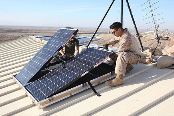 <p>On a combat outpost in Afghanistan in November 2012, two corporals in the USMarine Corps installed solar panels to provide power to radios, laptopsand computers.</p>