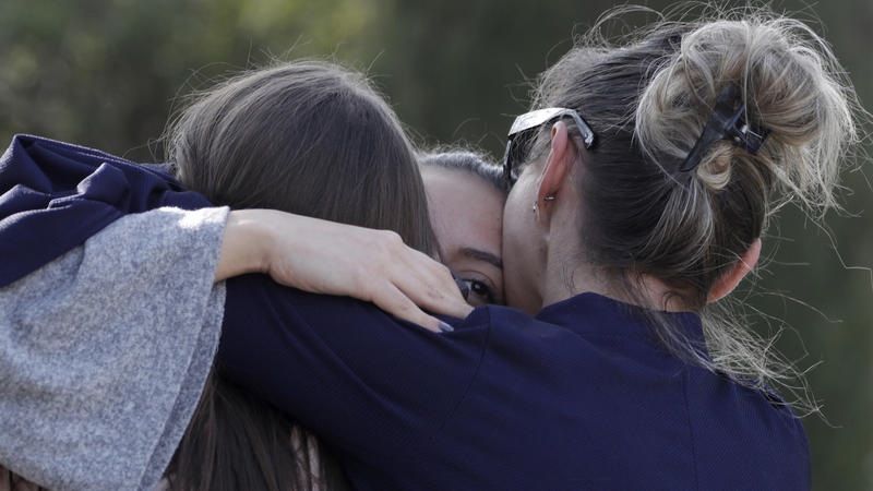 <p>People embrace near the Tocqueville high school after a shooting incident in Grasse, southern France, March 16, 2017.</p>