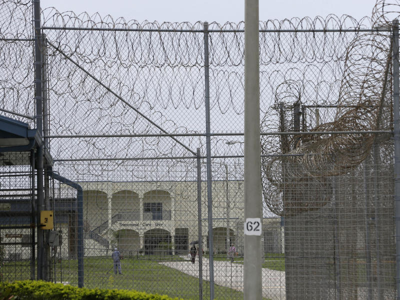 A prisoner works on the lawn at the Dade Correctional Institution In 2014, in Florida City, Fla. On Friday, Miami-Dade prosecutor Katherine Fernandez Rundle found no wrongdoing in the death of mentally ill prisoner Darren Rainey, who was locked in a showe