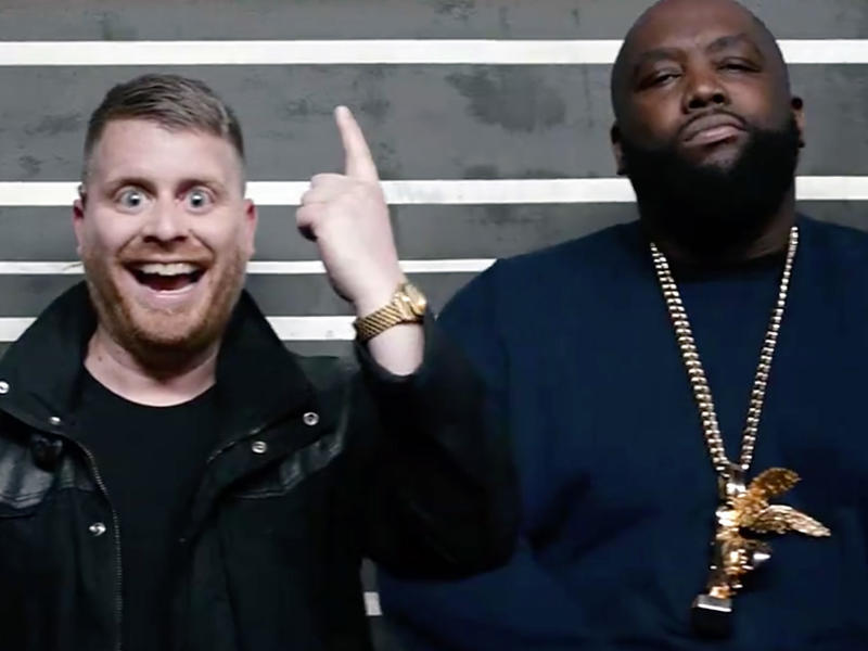 """Run The Jewels in a police lineup, in a scene for their new video for the song """"Legend Has It."""""""