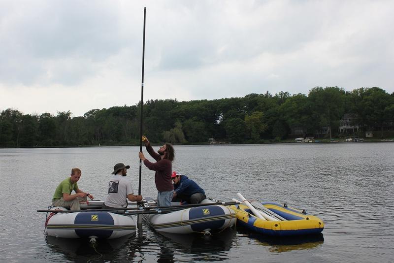 IUPUI researchers collecting sediment cores from Martin Lake, Lagrange County, IN (May 2013). From left to right, graduate student Owen Rudloff, assistant professor Broxton Bird, Michael Stouder, graduate student Lucas Stamps. (Bill Gilhooly/IUPUI)