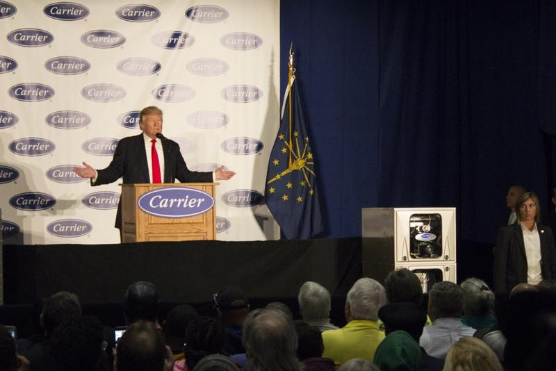 Then President-elect Donald Trump speaks to a crowd of reporters and workers at the Carrier plant on Indianapolis's west side in December 2016. He unveiled some details of the deal made with Carrier to protect more than 700 jobs. (Drew Daudelin/WFYI News)