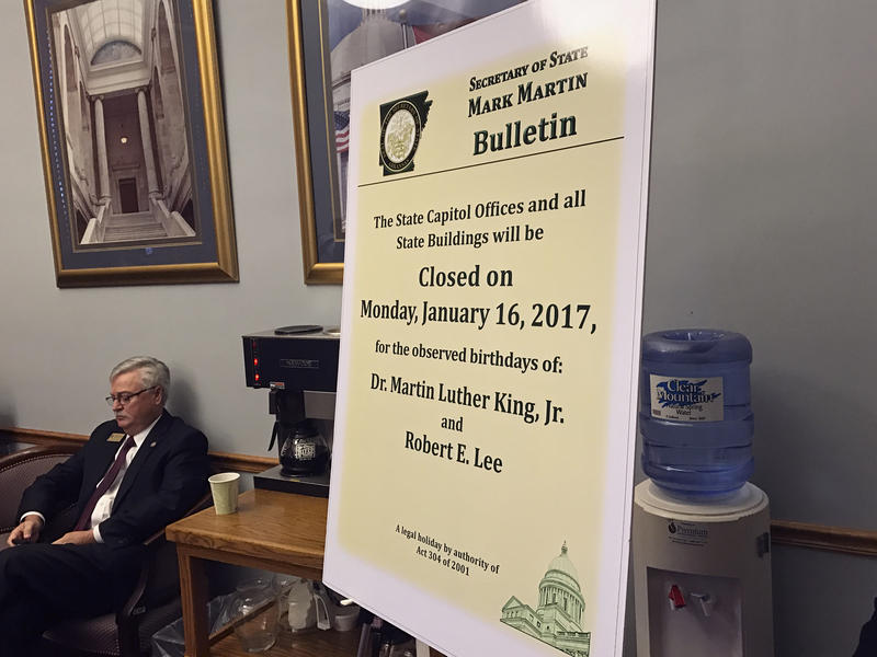 On of the notices posted marking the dual holiday honoring Confederate Gen. Robert E. Lee and slain civil rights leader Martin Luther King Jr., as posted at a Senate Education Committee hearing in Little Rock, Ark. Gov. Asa Hutchinson plans to sign into l