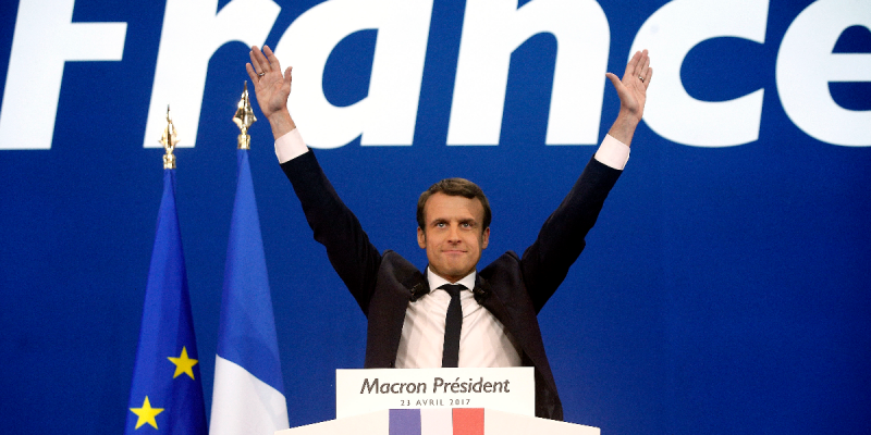 FILE - In this Sunday April 23, 2017 file photo, French centrist presidential candidate Emmanuel Macron waves before addressing his supporters at his election day headquarters in Paris. They could hardly be more different: Pro-European centrist Emmanuel M