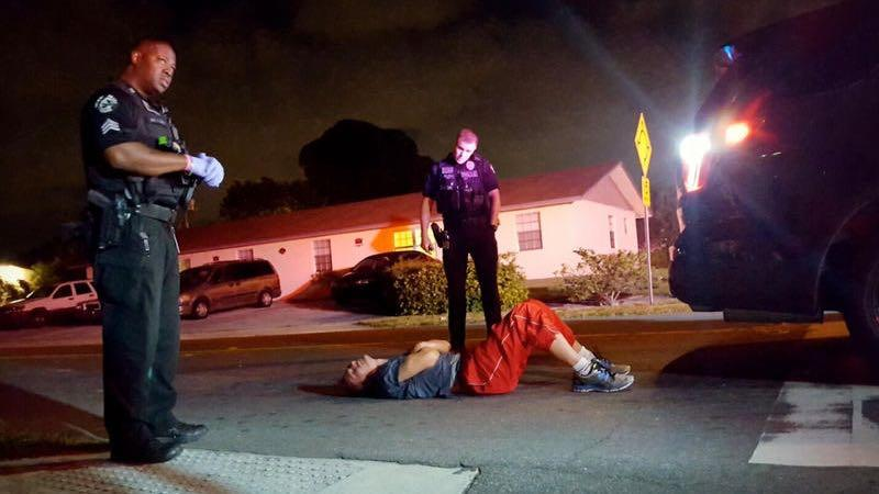 <p>A man convulses in the street from a heroin overdose two blocks away from the Delray Beach Police Station on Nov. 18, 2016.<br /> </p>