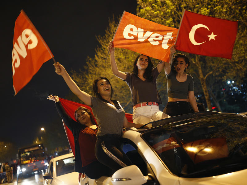 Supporters in Istanbul celebrated the historic referendum that consolidates power under the presidency.