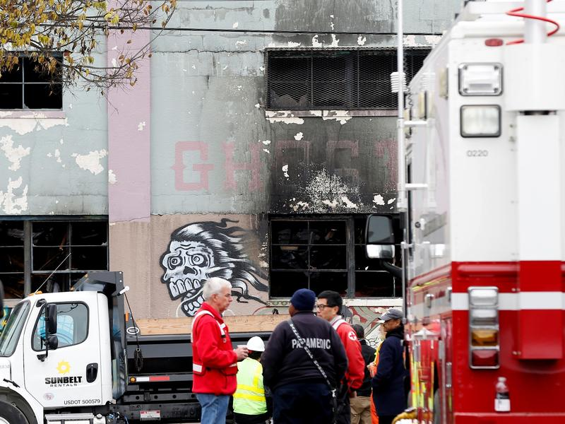 Firefighters and medics near the site of the Ghost Ship underground arts venue in Oakland, Ca., after a fire  claimed the lives of at least thirty-six people. The East Bay Times won a Pulitzer for its reporting around the tragedy.