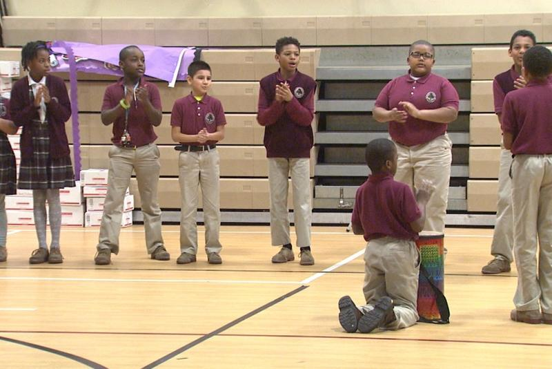 Students at Tindley Genesis Academy in Indianapolis participate in the morning meeting, which blends songs, chants and dancing. Music is at the center of all curriculum at the school. (Steve Burns/WTIU)